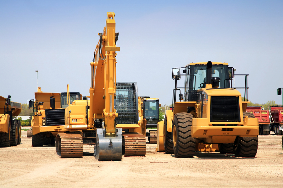 Large construction equipment being stored on the job site.