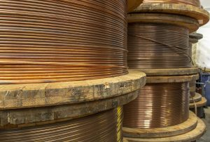 Large copper spools on a job site.