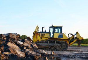 Large bulldozer on a big job site.